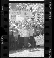 Anti-Fidel Castro demonstrators with Cuban flags and signs in Spanish and English, Los Angeles, 1980