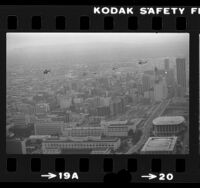 Five helicopters flying over Los Angeles Civic Center in tribute to failed hostage rescue mission in Iran, 1980