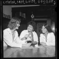 Nurse practitioner Rene Potik and aides discussing cervical cap in Los Angeles, Calif., 1980