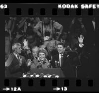 Ronald and Nancy Reagan at podium, waving at 1980 Republican National Convention in Detroit, Mich.