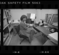Librarian Vivian Arterbery working at terminal of Rand Corp. library's barcode based computer system, 1980