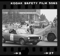 Los Angeles Department of Water and Power workers driving DWP rigs around City Hall in support of strikers in Los Angeles, Calif., 1980