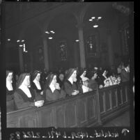 Nuns at High Mass on Thanksgiving Day at St. Vibiana's Cathedral in Los Angeles, Calif., 1961