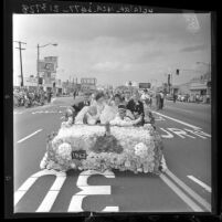 Royal court on float in Camellia Festival Parade in Temple City, Calif., 1962
