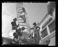 Don't Girl Marion Townsend,  demonstrates how not to climb fire engine ladder in Pasadena, Calif., 1948