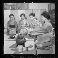 Mrs.Fujimura, wife of pastor of West L.A. Buddhist Church, conducts tea ceremony, 1962
