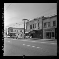 Business district with Jack's Tavern and Gospel Tabernacle on Adams Ave. in Los Angeles, Calif., 1962