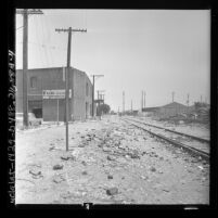Railroad track running behind Friend Furniture Corp. building on 29th Street in Los Angeles, Calif., 1962