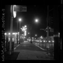 Night photograph of Flying A service station and traffic at intersection of 1800 W Jefferson Blvd and Western Ave. in Los Angeles, Calif., 1962