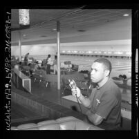Former football player, Woodley Lewis inside his Sportsman's Bowl bowling alley in Los Angeles, Calif., 1962
