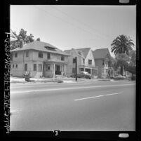 Three houses in African American neighborhood on E Adams Blvd in Los Angeles, Calif., 1962