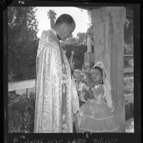 Blessing of the animals, Rev. Bernard O'Connor, pastor Old San Gabriel Mission, Calif., 1962