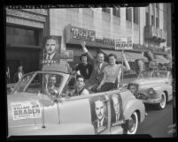 Young Republicans and Wallace Braden riding in cars covered with campaign signs in Los Angeles, Calif., 1948
