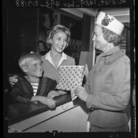 Jay North (aka Dennis the Menace) and actress Beverly Garland open Christmas Seal booth in Los Angeles, Calif., 1962