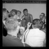 Cassius Clay giving press conference after he KO'd Archie Moore, 1962
