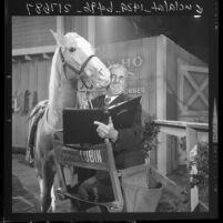 Arthur Lubin, film and TV director, kissing Mr. Ed, 1962