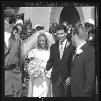 Ricky Nelson and Kristin Harmon, leaving St. Martin of Tours Church after their wedding in Brentwood (Los Angeles), 1963