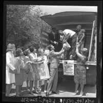 People loading truck for Food for Freedom, Calif., 1963