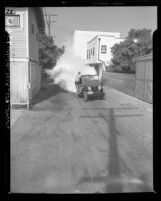 Mobile crew spraying solution of DDT and lephane in alleys of Santa Monica, Calif., 1948