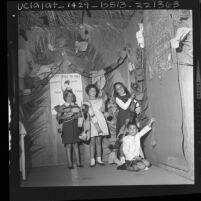 Children putting up harvest decorations in Congregation Shaarei Tefila synagogue in Los Angeles, Calif., 1963