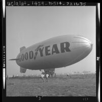 Ground crew tethering the Goodyear blimp, Columbia at Orange County Airport, Calif., 1963