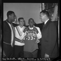 Los Angeles Lakers coach Fred Schaus with rookie Walt Hazzard, Elgin Baylor and Jerry West, 1964