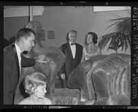 """Two couples viewing Henry Moore's """"Reclining Figure No.3."""" at Los Angeles Municipal Art Gallery preview party, 1963"""