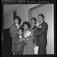 Navy chief steward Mauro Quimson with his children as they become U.S. citizens in Los Angeles, Calif., 1963