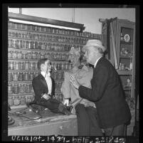Edgar Bergen talking with dummies Charlie McCarthy and Lars Lindquist in Bergen's workshop, Calif., 1963