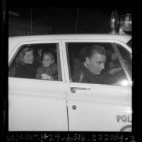 Patricia Lawford with daughter Sydney, in police car on way to airport after JFK assassination, Calif., 1963