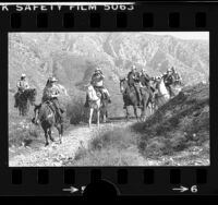 Sheriff's posse searching big Tujunga Canyon for flood victims, Calif., 1978