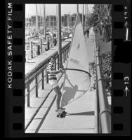 Hans Dose wind surfing on skateboard at Long Beach Marina, Calif., 1978