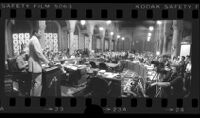 Mayor Tom Bradley speaking in city council chambers about proposed jobs cuts, panoramic, Los Angeles, Calif., 1978