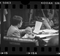 Councilman Zev Yaroslavsky holding his infant daughter Mina during meeting in Los Angeles, Calif., 1978