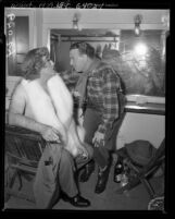 Comedians Broderick Crawford in drag with George Burns backstage during Friars Frolics in Los Angeles, Calif., 1950