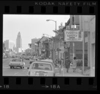 Street scene in Chinatown with Los Angeles City Hall in background, 1978