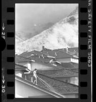 Residents watering down roofs as brushfire approaches in Hacienda Heights, Calif., 1978