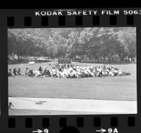 Iranian protesters praying in Hancock Park, Los Angeles, 1978