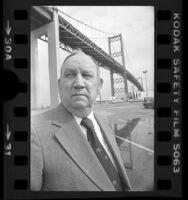 California Assemblyman Vincent Thomas standing under Vincent Thomas Bridge, Calif., 1978