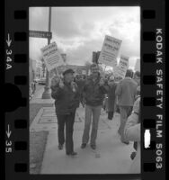 Actors Ed Asner and Dennis Weaver picketing during strike against advertising agencies in Los Angeles, Calif., 1978