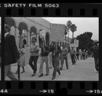 Off-duty Los Angeles police officers picketing for pay raises and more officers at City Hall in Los Angeles, Calif., 1980