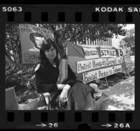 Linda Arrigo, wife of Taiwanese political prisoner Shih-Ming-Deh, seated outside Ronald Reagan's headquarters in Los Angeles, Calif., 1980