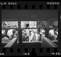 View from bus window looking out at parents picketing against school busing in San Pedro, Calif., 1980