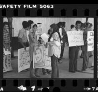 Iranian students with placards in Arabic and English demonstrating in Los Angeles, Calif. against American support of Iraq, 1980