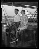 Errol Flynn and wife Nora Eddington Flynn on boat in Santa Monica, Calif., 1946