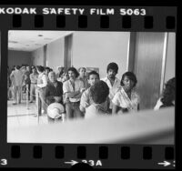 Line of people outside the immigration office in Los Angeles, Calif., 1980