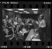 "Psychologist Dione K. Sommers addressing UCLA graduate students and their spouses on ""The Problems of a Dual-Career Marriage,"" in Los Angeles, Calif., 1980"