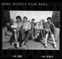 African American foster family, the Whitmores, with their three white foster children in Pasadena, Calif., 1980