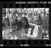 Leslie Kim Kawai hugging another contestant after being named Rose Queen in Pasadena, Calif., 1980