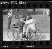 Disabled veterans Max Inglett and Bob Wieland greeting each other at Vietnam Veterans festival in Sylmar, Calif., 1980